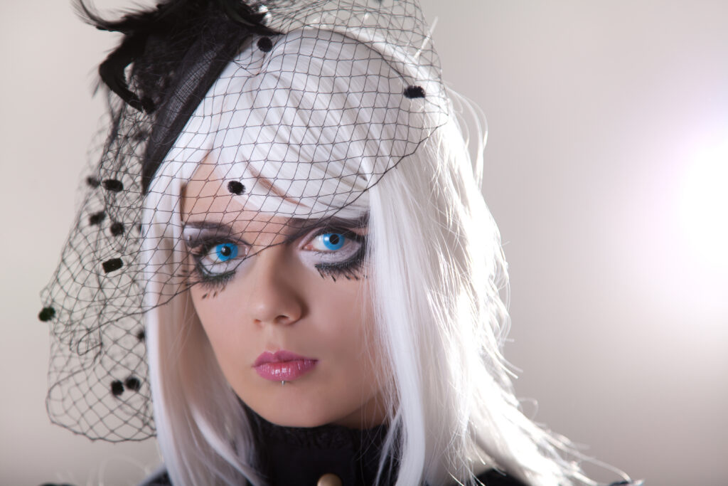 Portrait of young woman wearing blue contact lenses, studio shot